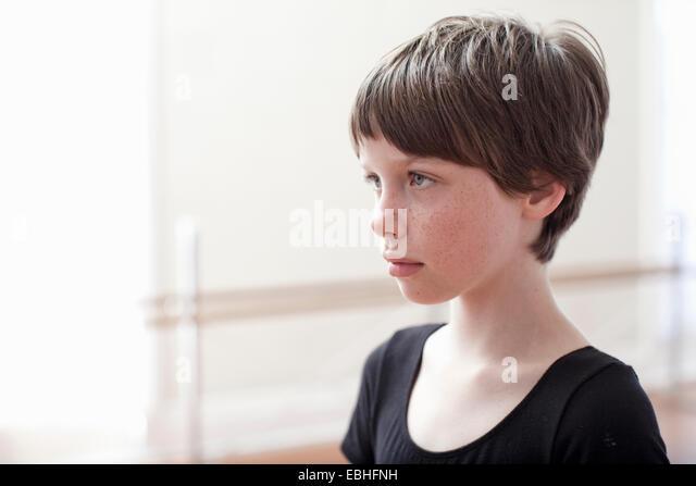 Portrait of sullen girl in ballet school - Stock Image
