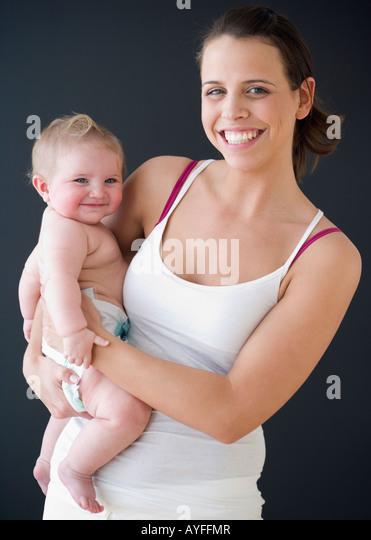 Mother holding baby - Stock-Bilder