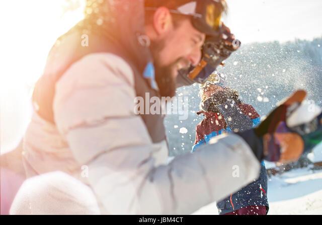 Playful couple enjoying snowball fight - Stock-Bilder