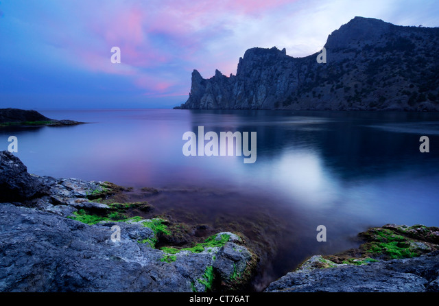 Black Sea coast on Crimea in Ukraine with Two Monks Rock - Stock Image