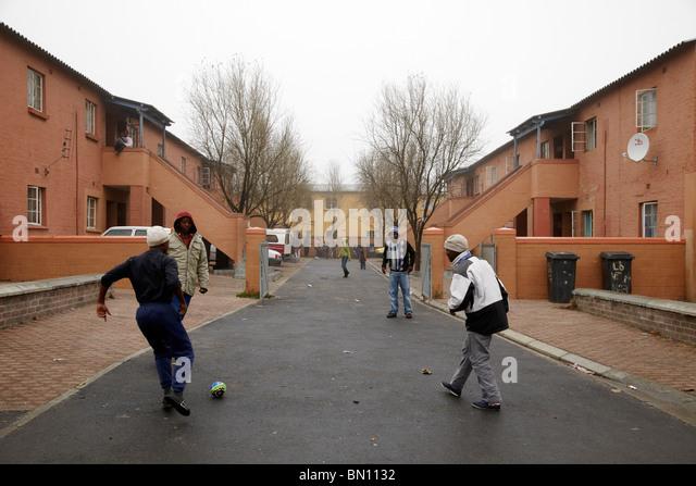 kids playing football in street Langa township - Stock-Bilder