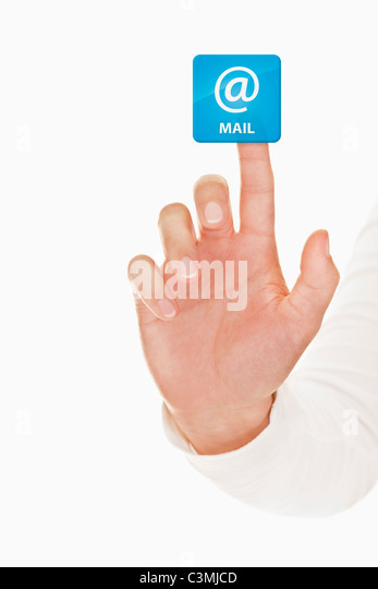 Human hand touching mail icon - Stock Image