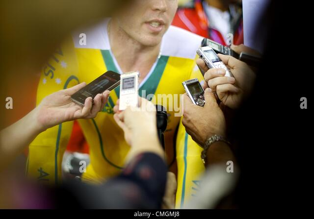 Aug. 7, 2012 - London, England, United Kingdom - Media swarm an Australian athelete at track cylcing events during - Stock Image