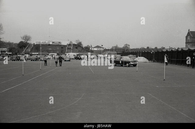 1960s, historical, picture shows cars negotiating flagposts in the car park at the Catford Greyhound Stadium, Lewisham, - Stock Image