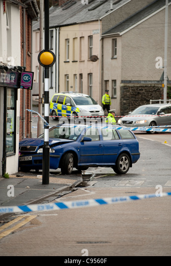 A road closed by police tape following a 3 car crash, Aberystwyth Wales UK - Stock Image