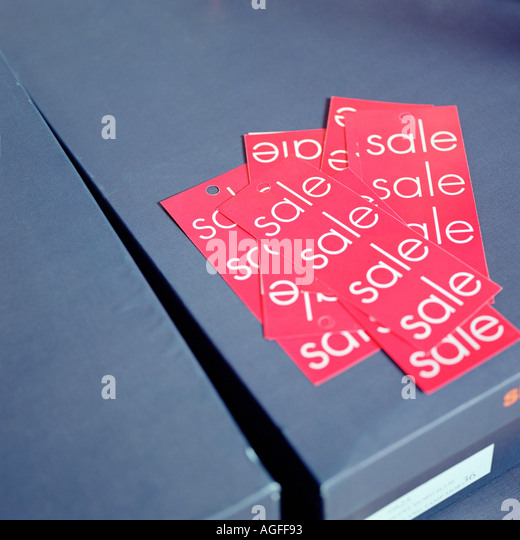 Sales labels on shoe box - Stock Image