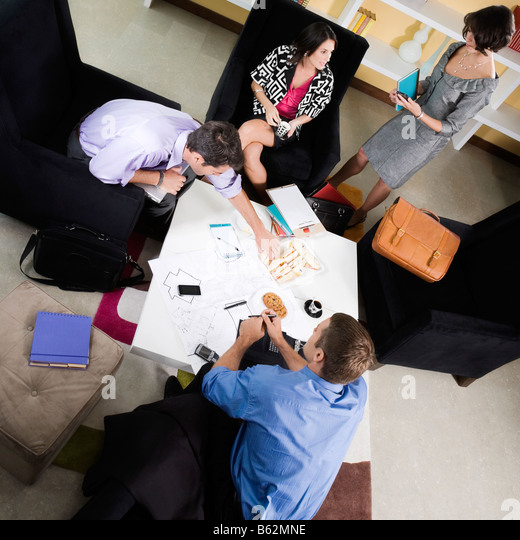 High angle view of business executives discussing - Stock Image