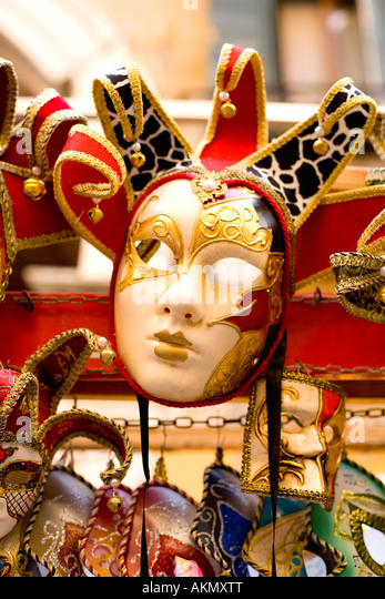carnival mask on display on market stall in venice - Stock Image