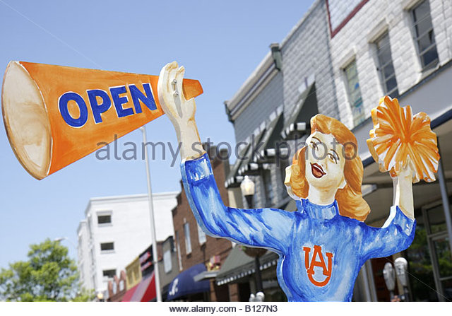 Auburn Alabama North College Street college town athletics Tigers female cheerleader cutout marketing business district - Stock Image