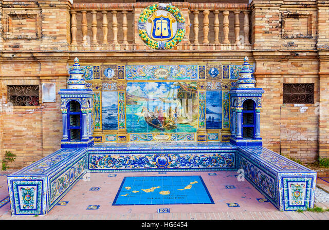 Glazed tiles bench of spanish province of Canarias at Plaza de Espana, Seville, Spain - Stock Image