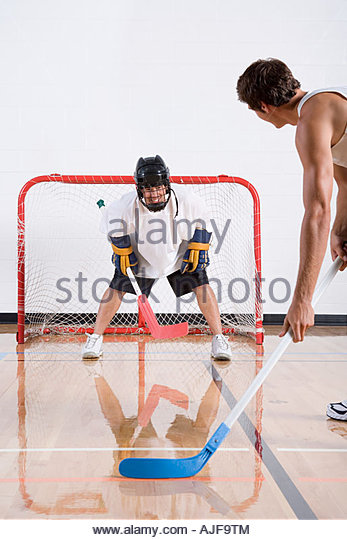 Two men playing hockey - Stock Image