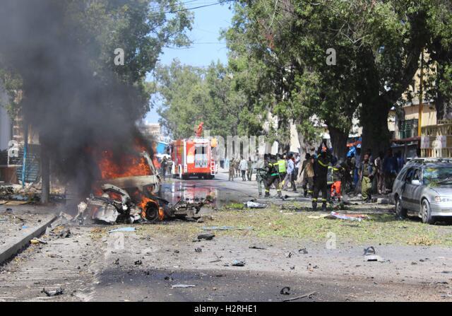 Mogadishu. 1st Oct, 2016. Photo taken on Oct. 1, 2016 shows the explosion site in Mogadishu, Somalia. At least four - Stock Image