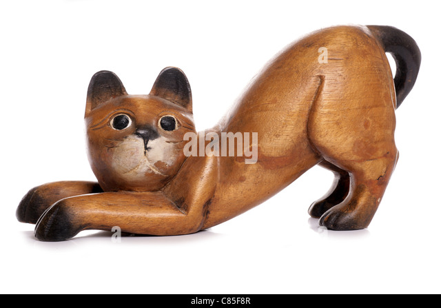 wooden cat ornament studio cutout - Stock Image