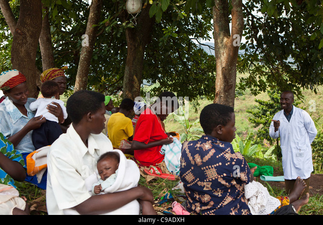 Women gather for health checks and to vaccinate their children. Bwindi Community hospital medical out reach clinic, - Stock Image