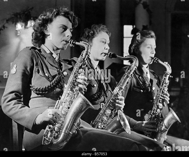 World War II Women. Three times the Sax. Three Sax players from the ATS dance band seen here performing. January - Stock-Bilder