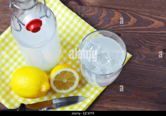 Still life photo of old fashioned or traditional homemade sour lemonade from an old style glass bottle. - Stock-Bilder