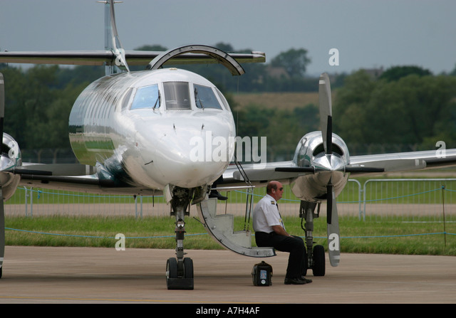 Pilot and airplane - Stock Image
