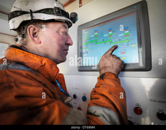 Miner operating process control panel in surface coal mine - Stock Image