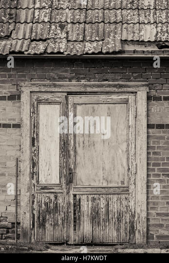 Closed door of old abandoned building. Vintage house front. Grungy architecture. - Stock-Bilder