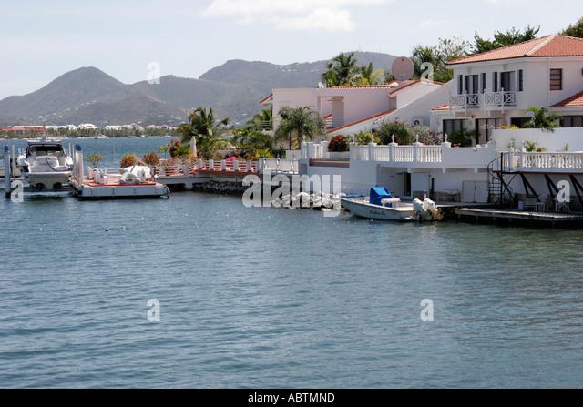 Sint Maarten Dutch Simpson Bay Lagoon Saint Martin beyond French waterfront homes boats - Stock Image