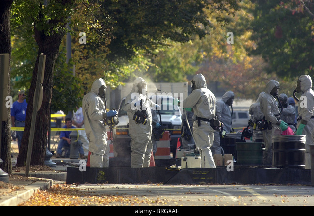 hazardous materials worker is sprayed down on Capitol Hill as buildings are still checked for anthrax contamination. - Stock Image
