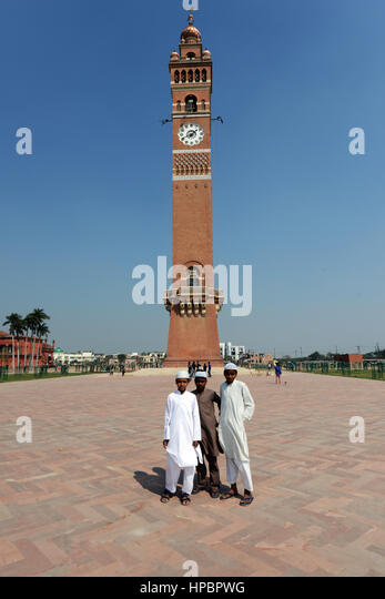 Muslim children standing in front of the Husainabad Clock Tower in Lucknow. - Stock Image