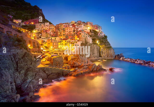 Manarola at evening night, Cinque Terre National Park, Liguria, Italy, UNESCO - Stock Image
