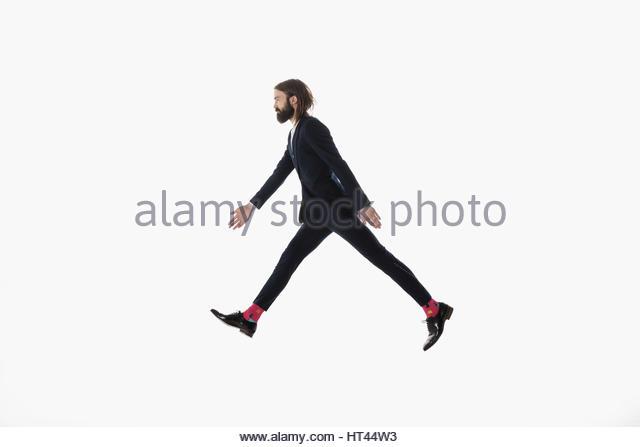 Businessman walking, striding against white background - Stock-Bilder