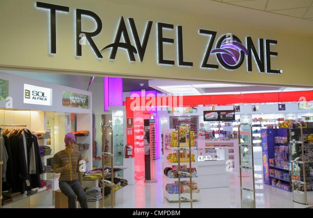 Peru Lima Jorge Chávez International Airport LIM aviation terminal concourse concession Travel Zone shopping - Stock Image