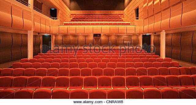 Seats in empty theater - Stock-Bilder