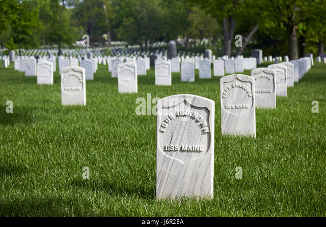 rows of white headstones including unknown sailors from the uss maine at arlington cemetery Washington DC USA - Stock Image