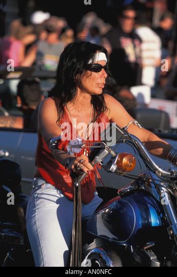 Daytona Beach Florida fl bike week woman on motorcycle annual party festival - Stock Image