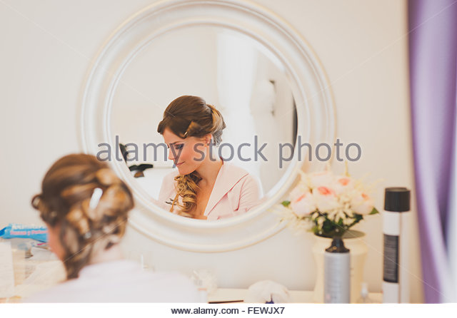 Reflection Of Woman In Mirror - Stock Image