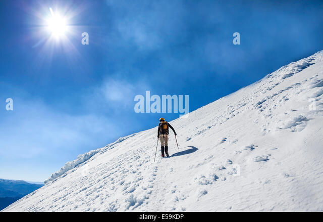 Climber on the way to the top of an active volcano Villarica in Chile. - Stock Image