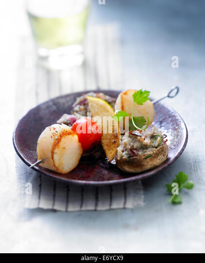 Scallop brochette with mushrooms stuffed with smoked duck magret - Stock Image