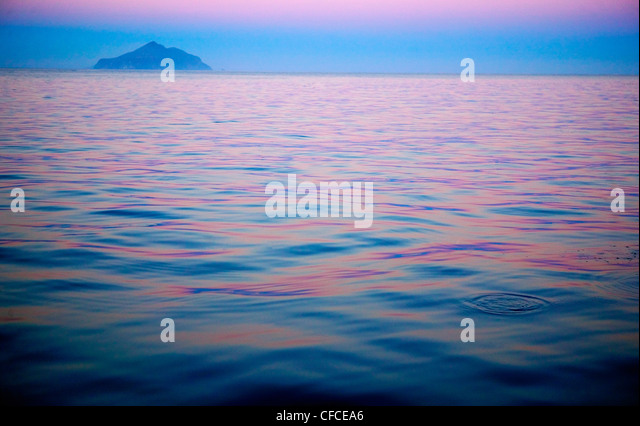 Summer twilight time for a boater at anchor off Anacapa Island, Channel Islands, California - Stock Image