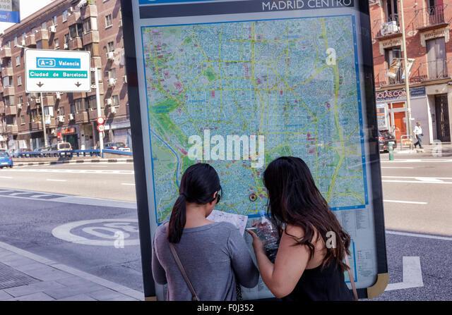 Madrid Spain Europe Spanish Centro Lavapias Ronda de Atocha woman friends street map - Stock Image