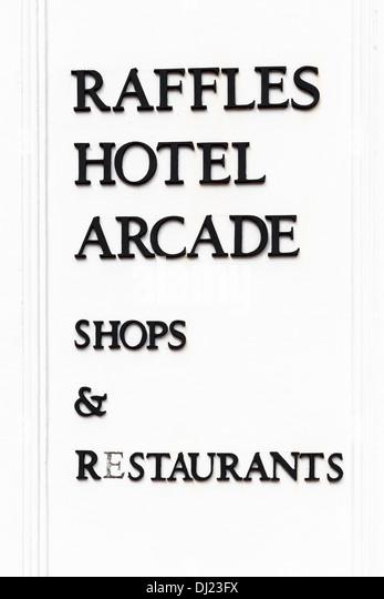 Raffles hotel arcade shops and Restaurant sign, Singapore - Stock Image