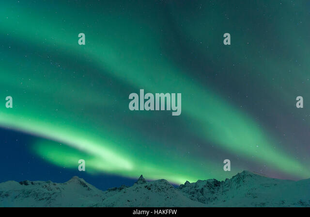 Nothern Lights with Mountains in Tromso, Troms, Norway - Stock Image