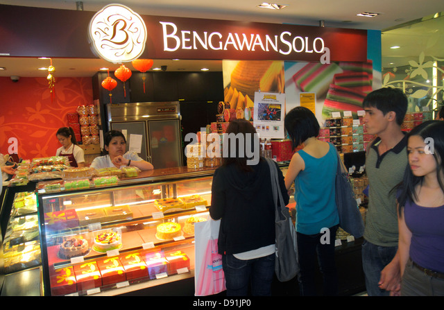 Singapore Orchard Road Plaza Singapura shopping mall complex Bengawan Solo cakes cookies desserts counter food Asian - Stock Image