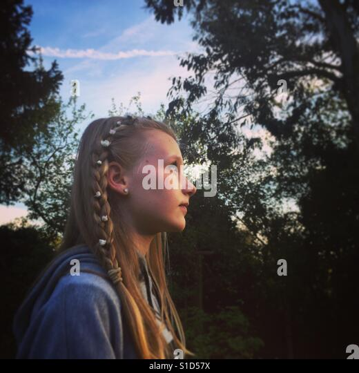 Portrait of girl with daisies in her hair. - Stock-Bilder