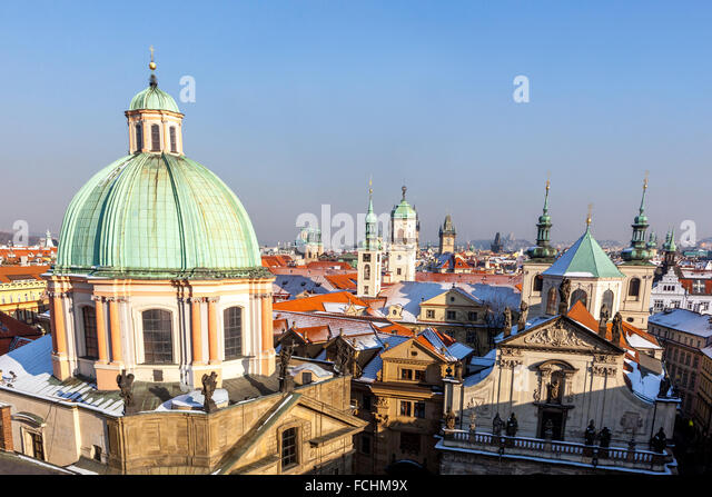Towers and rooftops of Old Town, dome of St. Francis of Assisi Church, Prague, Czech Republic - Stock Image