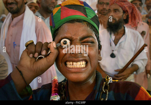 India. 14th Apr, 2016. (EDITORS NOTE: Image contains graphic content.) An Indian ascetic Muslim uses a sharp object - Stock Image
