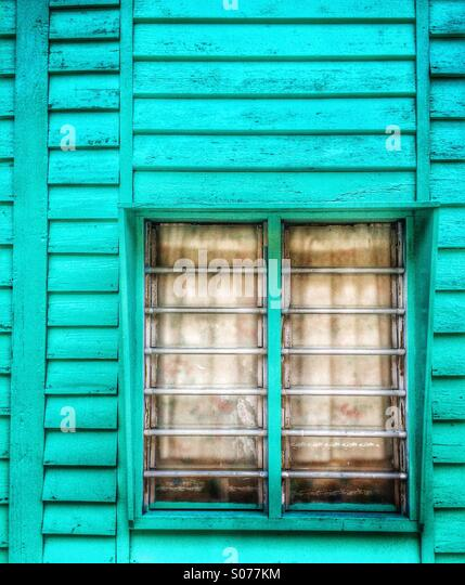 Malaysia old wooden house window at Crab Island fishing village Pulau Ketam - Stock Image