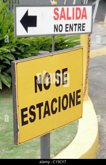 Panama Panama City Marbella traffic sign Spanish language no parking do not park exit arrow yellow curb - Stock Image
