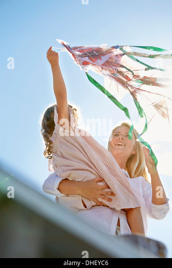 Mother and daughter playing with kite, Utvalnas, Gavle, Sweden - Stock Image