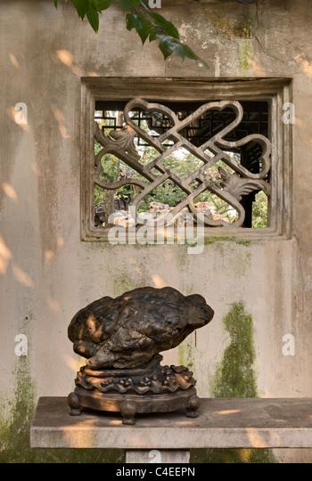 Scholars' Rock displayed in the Humble Administrator's Garden (Zhuo Zheng Yuan), Suzhou, China - Stock Image