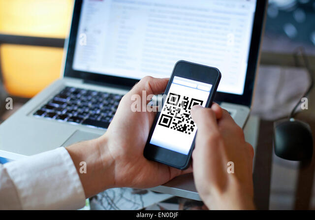 smart phone with qr code on the screen - Stock Image