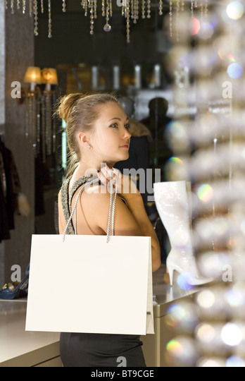 beautiful buyer with fawny bag in the boutique - Stock Image