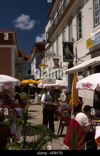 Portugal Cascais Rua das Flores alfresco dining eating food - Stock Image